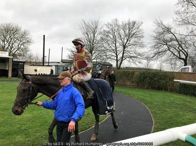 Mud Splattered Jockey on horse